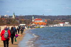 Sopot beach. People walk at Sopot beach on a sunny spring day. Photo taken on: May 01st, 2013 Royalty Free Stock Image