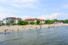 Sopot beach. Tourists enjoy the sunny weather and relaxing on the Baltic sea beach on 26 May 2018 in Sopot, Poland stock photo