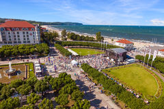 Sopot. Crowd of people walking on square near wooden pier in the distance, on August 09, 2015 in Sopot, Poland Stock Photography
