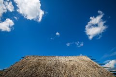 Sopot houses in Vinkovci. A detail of the straw roof on the old house with a view of the cloudy sky in the archeological ethnological park Sopot in Vinkovci Stock Image