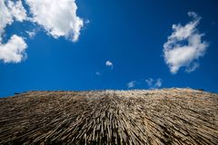 Sopot houses in Vinkovci. A detail of the straw roof on the old house with a view of the cloudy sky in the archeological ethnological park Sopot in Vinkovci Stock Photography
