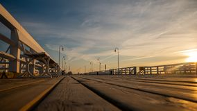 The Sopot Pier in the city of Sopot. The pier is the longest wooden pier in Europe. Beautiful sunrise royalty free stock image