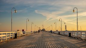 The Sopot Pier in the city of Sopot. The pier is the longest wooden pier in Europe. Beautiful sunrise royalty free stock photo