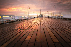Sopot pier at dawn. The first rays of the sun warms the wet boards of the pier in Sopot. Poland royalty free stock image