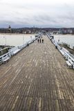 Sopot Pier Molo in the city of Sopot, Poland. People walking on a pier Molo in Sopot city, Poland. Built in 1827 with 511m long it is the longest wooden pier in stock photography