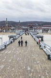 Sopot Pier Molo in the city of Sopot, Poland. SOPOT, POLAND - NOVEMBER 30, 2016: People walking on a pier Molo in Sopot city, Poland. Built in 1827 with 511m stock photos