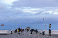 Sopot Pier Molo in the city of Sopot, Poland. SOPOT, POLAND - NOVEMBER 30, 2016: People walking on a pier Molo in Sopot city, Poland. Built in 1827 with 511m Royalty Free Stock Photos
