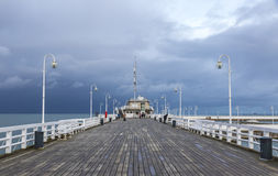 Sopot Pier Molo in the city of Sopot, Poland. SOPOT, POLAND - NOVEMBER 30, 2016: People walking on a pier Molo in Sopot city, Poland. Built in 1827 with 511m royalty free stock images