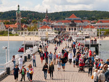 The Sopot Pier. SOPOT, POLAND - CIRCA 2014: The Sopot Pier in the city of Sopot is the longest wooden pier in Europe. Many people on jetty, circa 2014, Sopot royalty free stock photos