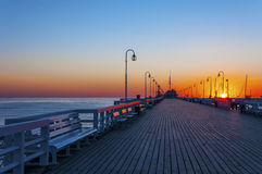 Sopot pier at sunrise. Sunrise at the wooden pier (molo) in Sopot, Poland stock images