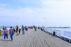 Sopot pier. Tourists enjoy the sunny weather and walking along the pier on 26 May 2018 in Sopot, Poland Stock Photo
