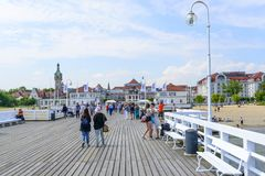 Sopot pier. Tourists enjoy the sunny weather and walking along the pier on 26 May 2018 in Sopot, Poland royalty free stock image