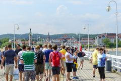 Sopot pier. Tourists enjoy the sunny weather and walking along the pier on 26 May 2018 in Sopot, Poland stock image
