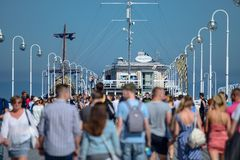 Sopot, Poland August 24, 2016. A crowd of people on the popular pier in Sopot on the main promenade of the city. Sopot, Poland August 24, 2016. A crowd of royalty free stock images