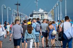 Sopot, Poland August 24, 2016. A crowd of people on the popular pier in Sopot on the main promenade of the city. Sopot, Poland August 24, 2016. A crowd of royalty free stock photography