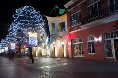 Crooked little house on Bohaterow Monte Cassino street at winter time at night royalty free stock images