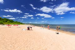 People on the sunny beach of Baltic sea in Sopot, Poland. Sopot, Poland - June 20, 2018: People on the sunny beach of Baltic sea in Sopot, Poland.  Sopot is Royalty Free Stock Image
