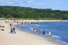Sandy beach on the Baltic sea, people resting on a sunny summer day, Sopot, Poland. SOPOT, POLAND - JUNE 6, 2018: Sandy beach on the Baltic sea, people resting stock photos