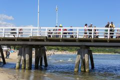 Wooden Sopot pier in sunny day, Sopot, Poland. SOPOT, POLAND - JUNE 6, 2018: Wooden Sopot pier in sunny day. It is the longest wooden pier in Europe, 511,5 m stock photos
