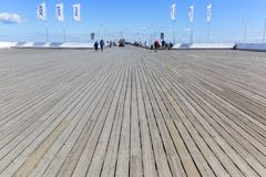 Wooden Sopot pier in sunny summer day, Sopot, Poland. SOPOT, POLAND - JUNE 6, 2018: Wooden Sopot pier in sunny day. It is the longest wooden pier in Europe, 511 stock photography