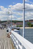 Wooden Sopot pier in sunny summer day, Sopot, Poland. SOPOT, POLAND - JUNE 6, 2018: Wooden Sopot pier in sunny day. It is the longest wooden pier in Europe, 511 royalty free stock photo