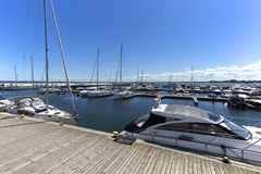 Wooden Sopot pier in sunny day, port for boats, Sopot, Poland. SOPOT, POLAND - JUNE 6, 2018: Wooden Sopot pier in sunny day, port for boats. It is the longest royalty free stock photography