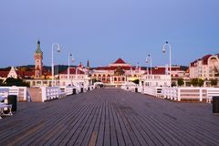 A long wooden pier in Sopot, Poland, with a view of the lighthouse. Sopot, Poland. A long wooden pier in Sopot, Poland, with a view of the lighthouse and other royalty free stock images