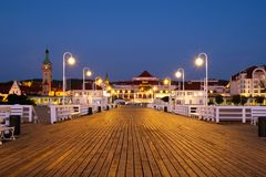 A long wooden pier in Sopot, Poland, with a view of the lighthouse. Sopot, Poland. A long wooden pier in Sopot, Poland, with a view of the lighthouse and other stock photos