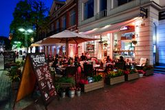 Monte Cassino Street, Sopot, Poland. Sopot, Poland - May 13, 2018: People are enjoying their night out in an outside restauran at Heroes of Monte Cassino Street Stock Image