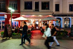 Monte Cassino Street, Sopot, Poland. Sopot, Poland - May 13, 2018: People are enjoying their night out in an outside restauran at Heroes of Monte Cassino Street Royalty Free Stock Image