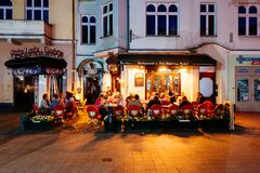 Monte Cassino Street, Sopot, Poland. Sopot, Poland - May 13, 2018: People are enjoying their night out in an outside restauran at Heroes of Monte Cassino Street Royalty Free Stock Photo