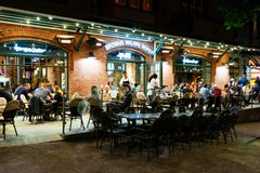 Monte Cassino Street, Sopot, Poland. Sopot, Poland - May 13, 2018: People are enjoying their night out in an outside restauran at Heroes of Monte Cassino Street Stock Photo
