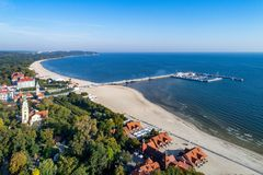 Sopot resort with pier and beach, Poland. Aerial view. Sopot resort in Poland. Wooden pier molo with marina, yachts, beach, old lighthouse, church, vacation royalty free stock photo