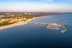 Sopot resort in Poland with pier, marina  yachts, ship and beach. Sopot resort in Poland. Wooden pier molo with marina, yachts, pirate tourist ship,  beach, town Royalty Free Stock Photos