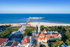 Sopot resort in Poland with SPA, pier, beach and old lighthouse,. Sopot resort in Poland. SPA , old lighthouse, wooden pier molo with marina, yachts, beach royalty free stock image