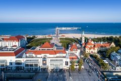 Sopot resort in Poland with SPA, pier, beach, hotels and old li. Sopot, Poland – October 1, 2017: Aerial view of Sopot resort with SPA, old lighthouse stock images