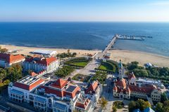 Sopot resort in Poland with SPA, pier, beach, hotels and old li. Sopot, Poland – September 29, 2017: Sopot resort with SPA, old lighthouse, wooden pier stock images