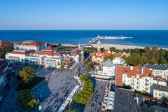 Sopot resort in Poland with SPA, pier, beach, hotels and old li. Sopot, Poland – October 1, 2017: Aerial vew of Sopot resort with SPA, old lighthouse royalty free stock image
