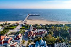 Sopot resort in Poland with SPA, pier, beach and old lighthouse,. Sopot resort in Poland. SPA, old lighthouse, wooden pier molo with marina, yachts, beach royalty free stock photos