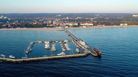 Sopot resort, Poland. Wooden pier with marina. Aerial video stock footage