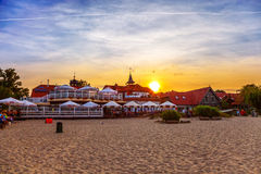 Sopot - Restaurant at sunset. People siting at the tables in the cafe at the beach in Sopot with sunset background. Photo taken on: September 18, 2012 Stock Image