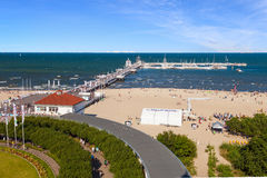 Sopot. Sandy beach scene of many people suntanning, relaxing and enjoying the shore in summer day on August 09, 2015 in Sopot, Poland Stock Photos