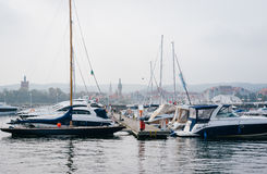 Sopot seafront viewed from the pier. SOPOT, POLAND - SEPTEMBER 10 2016: Midday haze at seafront of Sopot viewed from famous wooden pier with moored yachts in the stock image