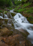Sopotnica waterfall and many cascades at cloudy day. Beautiful waterfalls and cascades in woods at cloudy morning. Travel destination Sopotnica, Serbia Stock Image