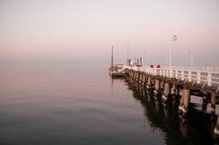 Sopotpijler bij zonsondergang stock afbeelding