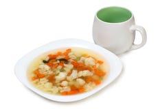 Soppa i den vita plattan Fotografering för Bildbyråer
