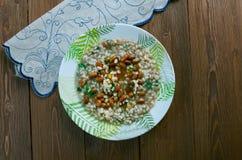 Soppa med pärlemorfärg korn och bönor Royaltyfria Bilder