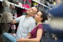 Sopping couple choosing towel at mall. Sopping couple choosing towel at the mall stock photography
