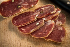 Soppressata, Italian Salami. Slices of typical italian pork salami Royalty Free Stock Images
