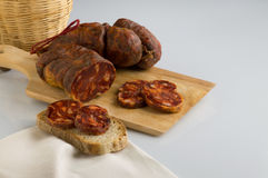 Soppressata, Italian salami typical of Calabria. Soppressata, sausage, Italian salami typical of Calabria, with basket stock photo